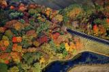 An aerial view of autumn foliage along U.S. Route 1 through Maine.