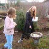 Two girls mapping biodiversity in a schoolyard