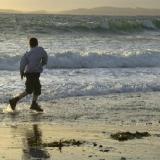 Kid on the beach at sunset